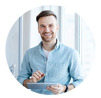 man smiling with tablet